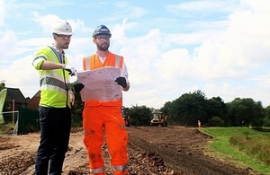 Image shows Chris Wosman and Ted Thomas on site at Lustrum Beck