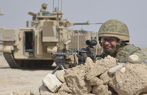 A soldier from 3rd Battalion The Mercian Regiment is pictured with one of the new up-armoured Warrior infantry fighting vehicles in Afghanistan