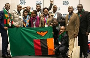 Chevening scholars with flag of Zambia
