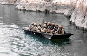 Soldiers from 3rd Battalion The Rifles aboard an assault boat on Kajaki's lake earlier this year