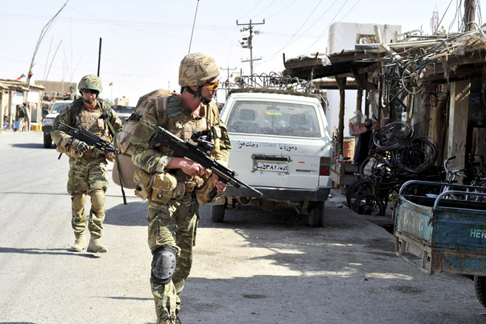 A patrol by the 40 Commando Police Mentoring Troop from Forward Operating Base Jackson in Sangin
