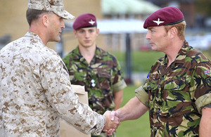 Lance Corporal Stephen Lewis, 2nd Battalion The Parachute Regiment (right), receives his (US) Navy and Marine Corps Achievement Medal from Major Timothy Wernimont, United States Marine Corps