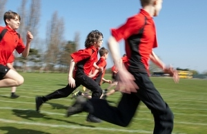 Pupils running outdoors