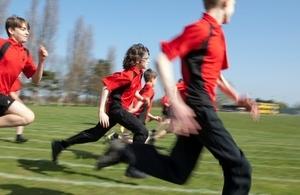 Pupils running outdoors