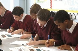 Secondary school pupils writing
