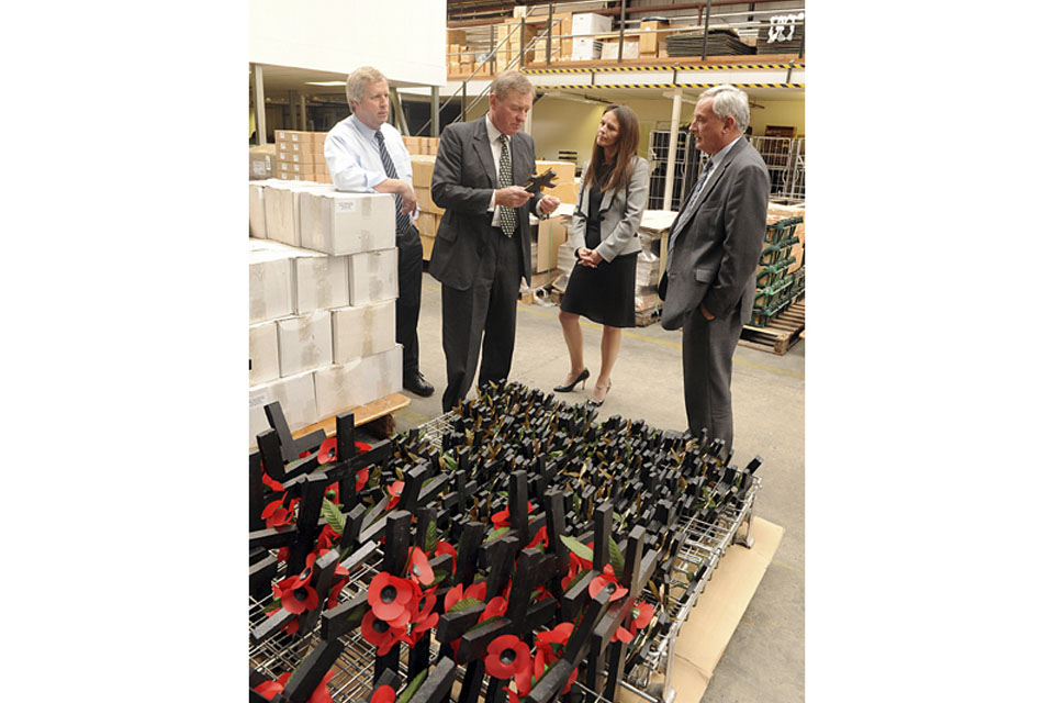 Minister for Defence Personnel, Welfare and Veterans, Andrew Robathan, in the Poppy Factory warehouse with the charity's Chief Executive, Melanie Waters