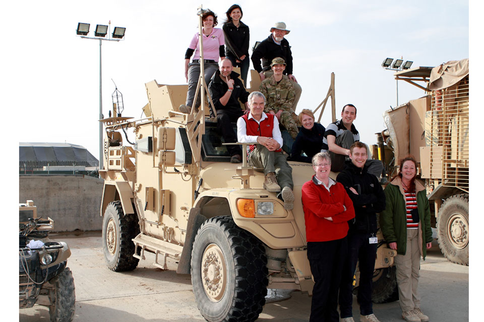 MOD civilians on Husky armoured vehicle at Camp Bastion