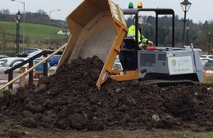 Image shows flood bank repairs taking place in Corbridge in March