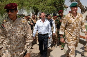 Dr Liam Fox visiting British and Iraqi troops in Basra, Iraq, in September 2008