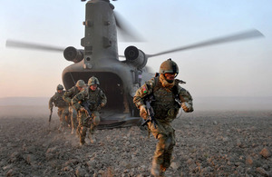 Soldiers dismount from a Chinook helicopter