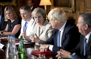 Prime Minister Theresa May, seated alongside Cabinet ministers, speaking in her Cabinet meeting at Chequers.