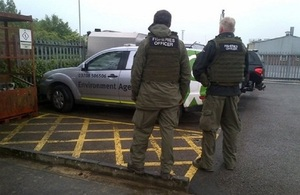 Images shows fisheries enforcement officers
