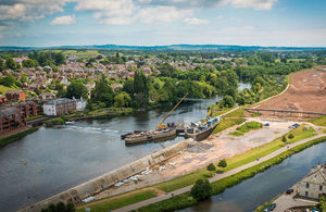 Aerial shot of tidal defence walls being built along the River Exe in Exeter