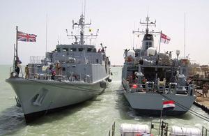 HMS Pembroke comes alonsgide HMS Chiddingfold