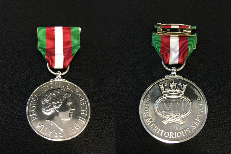 Image of the front and back of the Merchant Navy medal for meritorious service.
