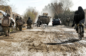 Soldiers from 3 PARA on patrol in an Afghan village