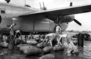 Armourers assemble 500-pound (228kg) medium capacity bombs for loading into Consolidated Liberator B Mark VI, KL654, of 356 Squadron for the squadron's first operational mission, and the first bombing operation flown from Brown's West Island in the Cocos