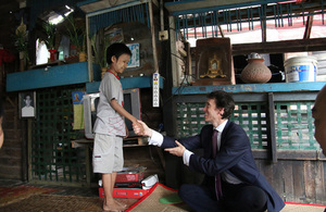 Minister of State for International Development, Rory Stewart MP OBE, meets a child during his visit to Burma. Picture: DFID