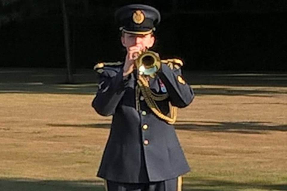 A bugler playing the Last Post during service for Sgt Pulman, Crown Copyright, All rights reserved