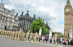 Personnel from 20th Armoured Brigade march to the Palace of Westminster