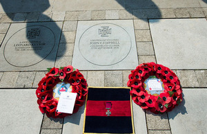 The commemorative paving stone is unveiled