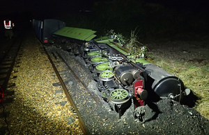 Derailed train after the collision, shown on its side