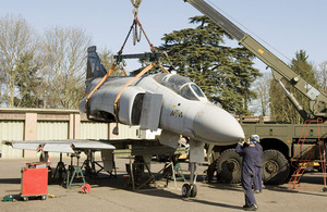 The team carefully lift the Phantom's fuselage away from the wings