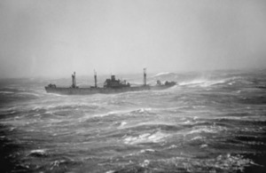 A Liberty Ship in convoy RA64 sails through heavy seas in the Arctic Ocean