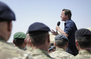 Prime Minister David Cameron speaking to ISAF personnel at Camp Bastion