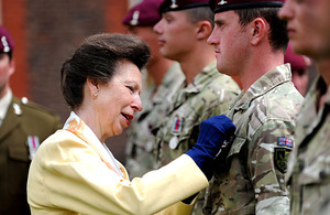 HRH The Princess Royal pins an Operational Service Medal to the chest of a soldier