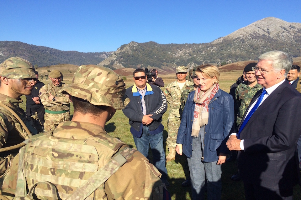 Michael Fallon and Albanian Defence Minister Mimi Kodheli meet troops at Biza.