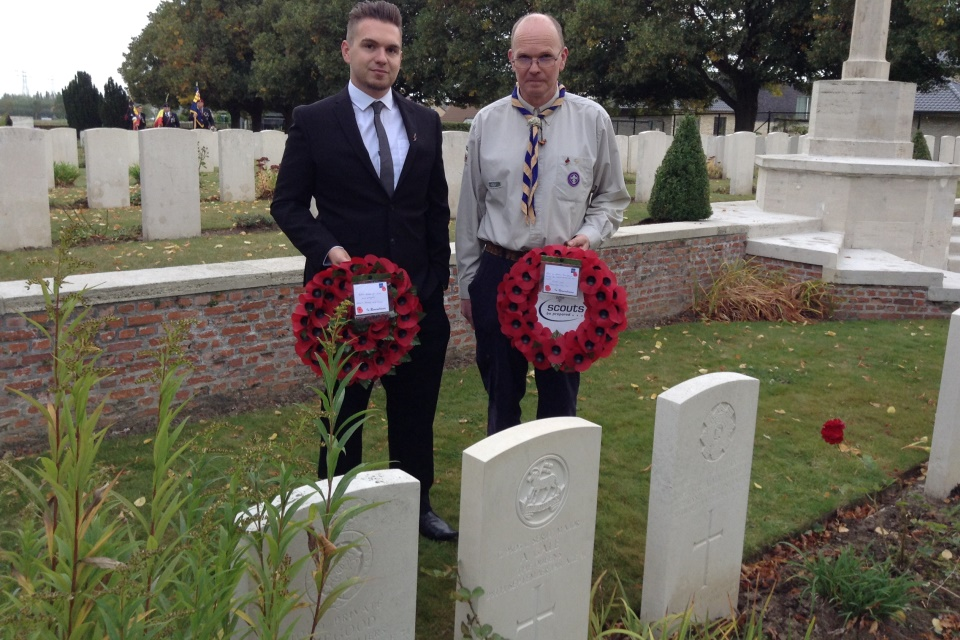 (left to right): Guy Boxall (son of Gary Boxall) and Gary Boxall great grandson of CSM Gale hold poppy wreaths by the headstone - Crown Copyright - All rights reserved