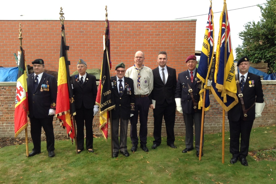 (left to right): CSM Gale's great grandson Gary Boxall and his son Guy Boxall stand side by side the Belgium flag bearers and two representing the Royal British Legion - Crown Copyright - All rights reserved