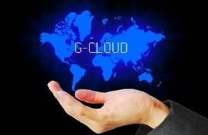 Hand with world image hovering over it overlaid with word G-Cloud