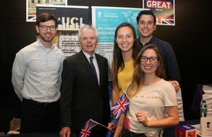 British university officers with Ambassador Patrick Mullee and students