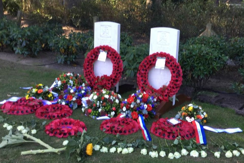 Poppy wreaths are laid at the headstones of LCpl Noble and Pte Lewis. Crown Copyright, All rights reserved