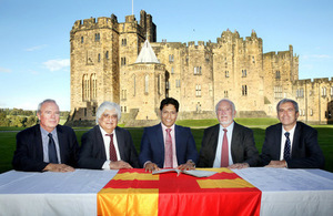 Leaders signing the MOU with Alnwick Castle in the background