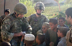 Captain Giles Walsh makes friends with local Afghan children
