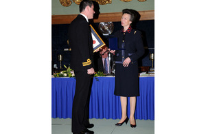 Lieutenant Commander Graham Chesterman collects the Edward and Maisie Lewis Award