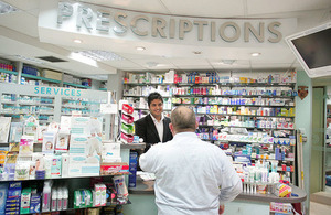 Pharmacist serving a customer