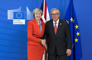 Prime Minister Theresa May shaking hands with European Commission President Jean-Claude Juncker.