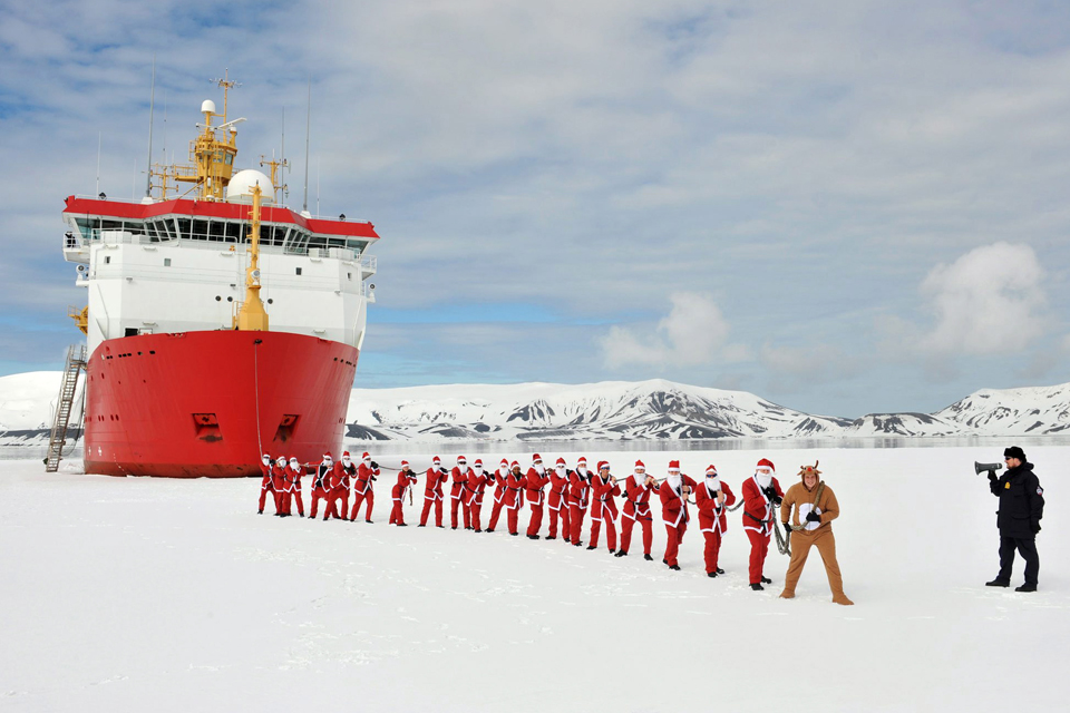 HMS Protector's Father Christmasses on the start line