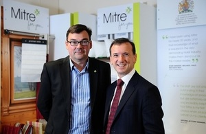 Mitre Linen MD Jim Mangan with Welsh Secretary Alun Cairns.JPG