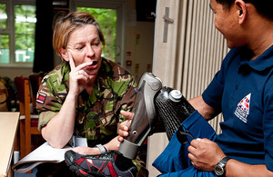 Corporal Hari Budha Magar chats with Major Melanie Barbour