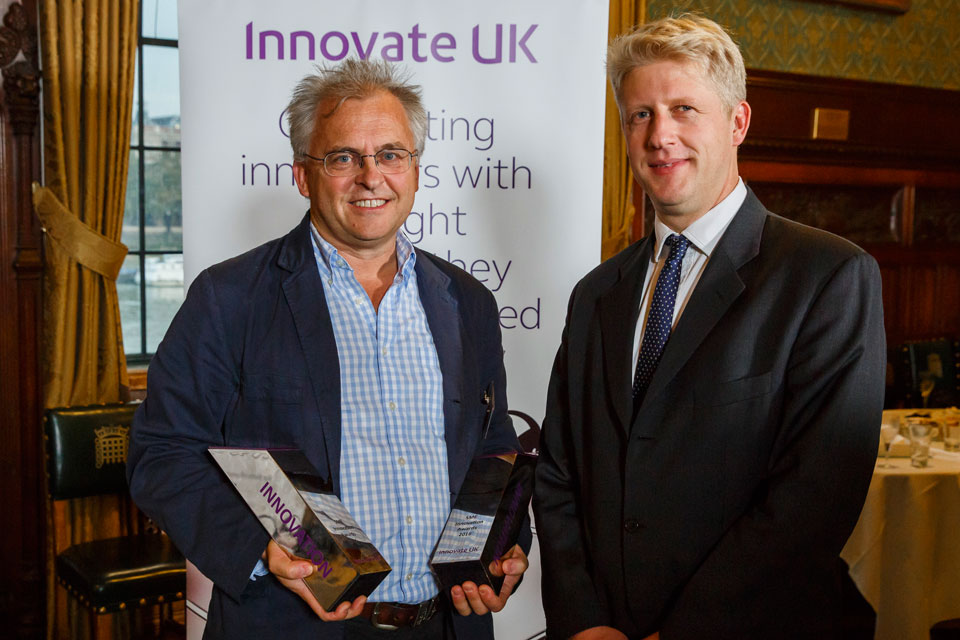 Jo Johnson MP, Minister of State for Universities, Science, Research and Innovation, presenting the inspirational innovation award to Dearman CEO Toby Peters at the SME innovation awards 2016.