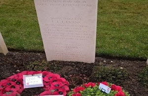 Wreaths laid by the headstone of Sergeant Frederick Evans, Crown Copyright, All rights reserved