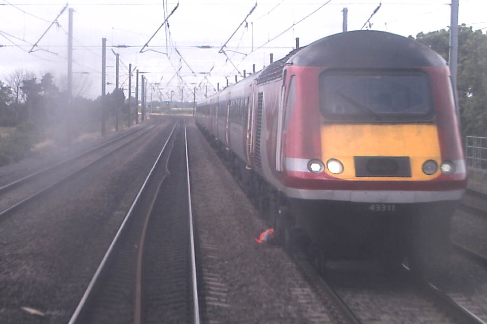 Still image from forward facing CCTV of train 1S16 showing the driver of 1E13 lying in the space between the Up and Down Fast Lines (courtesy Virgin Trains East Coast)
