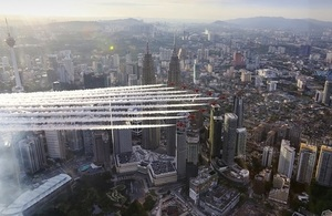 The Red Arrows flying past the PETRONAS Twin Towers