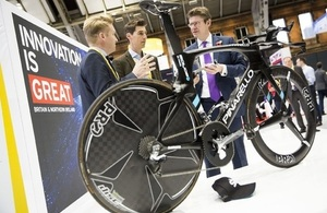 University of Sheffield's Sam Turner and James Hunt talk to Rt Hon Greg Clark MP, with the Team Sky bike at Innovate 2016, Manchester Central Conference Centre.