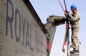 An Air Engineer maintaining the tail rotor of a Royal Navy Sea King helicopter at Camp Bastion